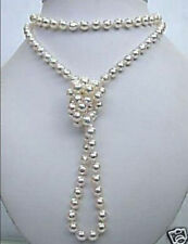 Superb natural white salt water Shell pearl necklace 48 inchs
