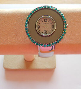 Watch Womans Cuff round white face-turquoise rhinestone trim,  silver band,