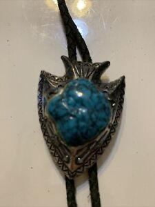 Silver Tone Arrowhead Bolo Tie With Faux Turquoise Stone In Center On Nylon Rope