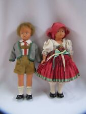 Antique German Dolls Bisque Plastic Boy and Girl Traditional Clothes Set of 2