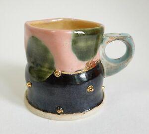 Contemporary studio pottery pink and black mug