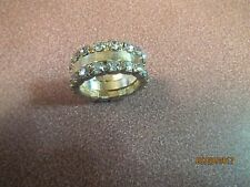 NWOT LADIES GOLDTONE CRYSTALS SURROUND THIS Gold Tone Band FASHION Ring SIZE 7