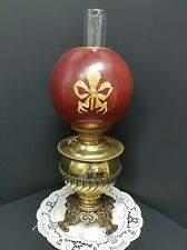Antique Juno Brass Oil Lamp with Red and Gold Bow Ball Shade