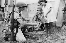 WW2 Picture Photo 1942 US soldier getting water from a girl 1366
