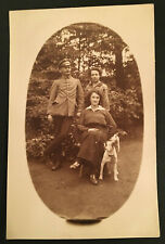 Vintage RPPC Photo of Military Soldier in Uniform his Family & Faceless Dog 4445