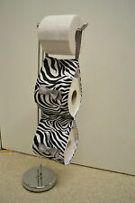 The zebra print fabric decorative toilet rolls holder with grey bows .