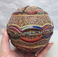 Decorative ball with glass beads and stone chips