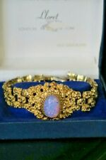 22ct Gold plated Bracelet , Textured brick strap , Faux opal centre . Boxed