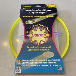 Aerobie Skylighter Frisbee LED Illuminated Flying Disc Neon Yellow