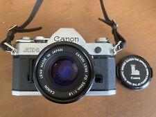 Canon AE-1 35mm SLR Film Camera con obiettivo FD 50mm-ARGENTO. in buonissima condizione.