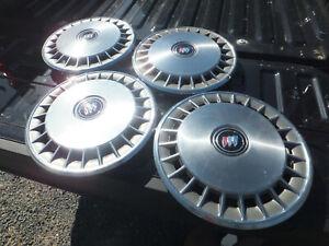 "4 NOS GM 14"" Hub Caps Wheel Covers 25516338 1984-96 Buick Century Skylark 999230"