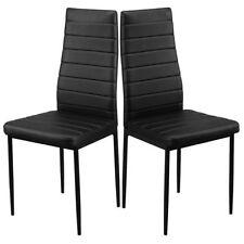 Chaises noires en métal pour la salle à manger
