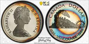 1986 CANADA SILVER DOLLAR PCGS PR67DCAM TARGET TONED RAINBOW COLOR UNC (DR)