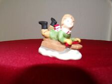 lefton colonial village figurines: Tommy Reed 00657 Boy on his sled.