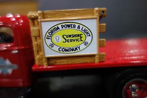 REDDY KILOWATT FLORIDA POWER 1ST GEAR STAKE TRUCK DIE CAST 1:34 Scale-RED