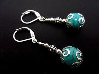 A PAIR OF DANGLY TURQUOISE  BEAD  SILVER PLATED DROP LEVERBACK HOOK EARRINGS.