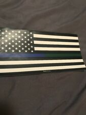 THIN GREEN AND THIN BLUE LINE BLACK AND WHITE AMERICAN FLAG STICKER.