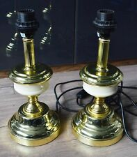 A Set Of Two Gold Coloured Table Top Lamp Stands.
