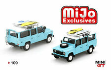 MINI GT MGT00109 LAND ROVER DEFENDER 110 WITH RACK & SURFBOARD LIGHT BLUE 1/64