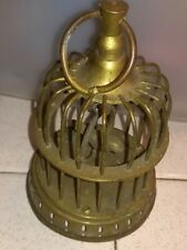 antique brass bird in cage