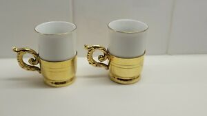 2 PORCELAIN CUPS IN GOLD HOLDERS