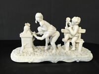 Statuina in ceramica d'epoca