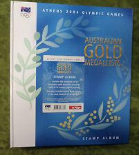 #HH.  2004 ATHENS OLYMPIC GAMES GOLD MEDALLISTS STAMP FOLDER