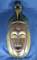 Decorative african mask with bird figurine