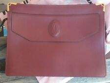Must the Cartier pochette vintage burgundy