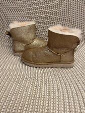 UGG Women's Mini Bailey Bow Sparkle Sheepskin Boots Gold Size 9