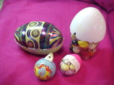 candy containers. one tin egg, one plastic chicken, tin ornament and small egg.