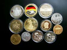 12 neu moderne Medaillen  Gewicht 280 Gramm