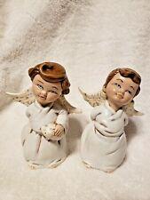 Pair of Ceramic Angels Boy Holds Slingshot & Girl Holds Hammer & Piggybank
