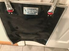 Kate Spade Black Patent Tote with Silver Handles and detailing.