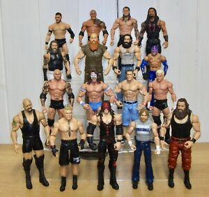 Set of 4 WWE wrestling figures inc. Roman Reigns, Drew McIntyre & Randy Orton