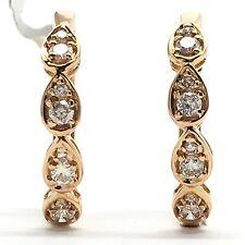 14k rose gold pear shape hoop earrings. Tdwt 0.30 ct.