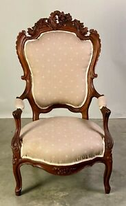 NICELY CARVED ROCOCO REVIVAL WALNUT ARMCHAIR.
