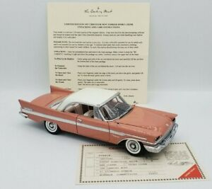 1957 Chrysler New Yorker Sports Coupe in Rose by Danbury Mint 1:24 Diecast