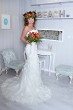 Ex sample designer wedding dress size 10/12. Stunning ivory lace fit and flare