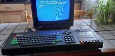 ORDINATEUR QWERTY AMSTRAD CPC 464/K7+jeux compilation +carton original