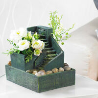 Zimmerbrunnen mit Pflanzen und Stufen aus Stein, Brunnen für Zimmer