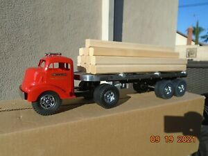 SMITH MILLER GMC LUMBER TRUCK WITH LUMBER NEW IN THE BOX.