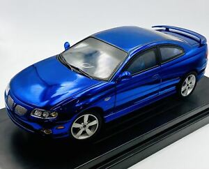 1:18 2004 Pontiac GTO -- Candy Blue -- American Muscle ERTL Collectibles