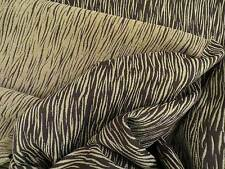 Reversible chenille textured upholstery material with short wavy stripe pattern