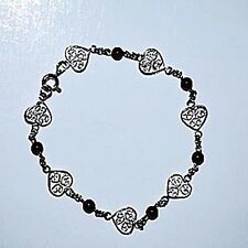 Silver filigree bracelet with garnet stones Hughes Jewelry 7 inches