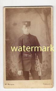 Soldier in uniform, with brass instrument, Finchley, CDV