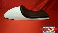 VINCENT STYLE FIBREGLASS CAFE RACER SEAT FINISHED IN WHITE WITH BASIC BLACK PAD