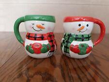 Pair Of Snowman And Snowwoman Mugs Each Holding Mug Christmas
