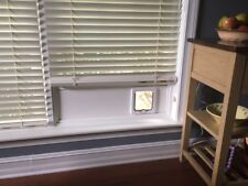 Cat Door Window Insert. Made with solid Pvc base and locking flap. Order yours!