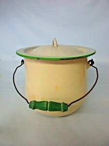Vintage enameled chamber pot with lid